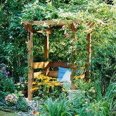 Backyard Landscaping Ideas Garden Structure Garden Arbor with Seat: A garden arbor can provide more than a focal point: This one also offers a beautiful place to sit. Flowering vines clad the arbor, a great way to create vertical garden space. Perennial vines--those that come back year after year--include roses, clematis, and trumpet vine.