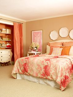 Not my colors but love the plates above the bed and the curtains versus closet doors :)