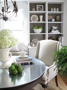 Love the table top in silver/gray and the white with a few touches of green and the open shelving with gray back. Lovely