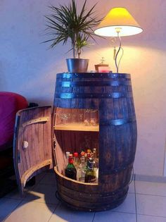 DIY Wine Barrel Cabinet. Lots of ideas and tutorials to make useful things with old barrels! Cool gifts for wine lovers.