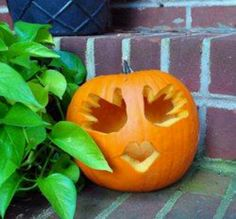 You can trace your kids hands onto the pumpkin and use the handprints as the eyes.. brilliant!