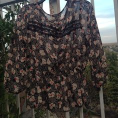 Lily Rose Blouse Beautiful blouse. Black and cream with soft red flowers. 23 inches in length and 18.5 inch sleeves. In like new condition. Lily Rose Tops Blouses