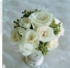 Similar blooms clustered in mint julep cups topped the tables-Bianca roses, white spray roses, and green hydrangeas.