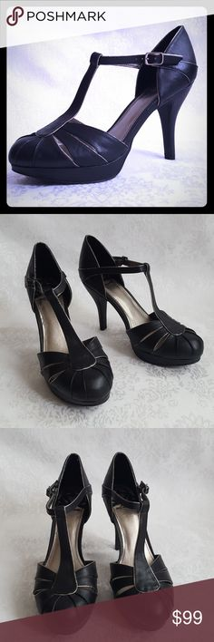 """NWOT Fergalicious Black Strappy Heels Fergalicious black T-strap platform heels with gunmetal trim with 4"""" heel and 1""""platform. Rounded toe with pleated top and side cut outs.  Adjustable ankle strap with buckle. Style is """"NADIA"""".  New, without tags. Excellent condition. Smoke free and pet free home.  Check out my other listings - 100's of 👠shoes👠, 👢boots👢 and 👜bags👜. Bundle 2 or more and save money!💲💰💲(81603)26a8 Fergalicious Shoes Heels"""