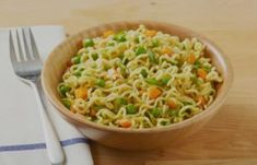 Bored of making the same Maggi recipe with peas and carrots? Check out our vegetarian Maggi recipe with a cheesy twist! Our cheesy vegetable Maggi will be one of your most desired Maggi dishes ever. Indian Food Recipes, New Recipes, Ethnic Recipes, Peas And Carrots Recipe, Maggi Recipes, Fish Curry, Indian Street Food, Food Staples