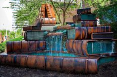 """A-brain-hungry: """"Book fountain is a fountain located just outside the Cincinnati Public Library.  According to the bookstore, """"the sculpture has a waterfall over a pile of ceramic books, representing the free flow of ..."""