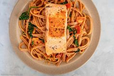 Sun Dried Tomato Pesto and Pan-Seared Salmon Tagliatelle with Homemade Creamy Tomato Sauce || Love salmon? Get a taste of Italy with this salmon pasta with creamy sun-dried tomato pesto sauce! Learn how to make pan-seared salmon with creamy tomato pasta in 30 minutes. Check out this creamy pasta with salmon recipe on Travelling Foodie. #travellingfoodie #recipes #easyrecipes #pastarecipes #creamypasta Salmon Pasta Recipes, Creamy Salmon Pasta, Creamy Tomato Pasta, Tomato Pesto, Easy Pasta Recipes, Pesto Pasta, Pesto Sauce, Pasta Noodles, Homemade Tomato Pasta Sauce
