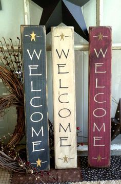 WELCOME primitive vertical sign    Approximately 2.5x14 (may vary by 1/2)  hand painted lettering  saw tooth hanger on back  stained on backside