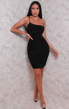 Slay it in slinky this season and dial up the sass in our Black One Shoulder Ruched Slinky Bodycon Mini Dress. Featuring a thin strappy one shoulder design with ruched sides and a luxe slinky style, we're all about this dress. Heading on a BNO with the girls and wanna seriously slay it? Team with an Ari inspired ponytail, sparkly heels and full glam for a look that will bang on the 'gram, girl!