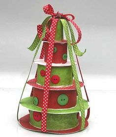Great upcycled ribbon spool tree (could even make gift boxes out of them). I always hate throwing ribbon spools away, but never know what to do with them.. Finally, an idea! :)