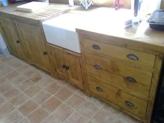 Rustic farmhouse kitchen belfast sink unit with free choice design on cupboards & drawers..shown in a waxed brown finish with grey metal cup handles & knobs.