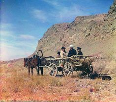At work on the upper reaches of the Syr-Darya, Golodnaia Steppe, Four men on a horse-drawn cart, next to a cliff; between 1905 and 1915 Sergei Mikhailovich Prokudin-Gorskii Collection (Library of Congress). #