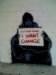 There is a common perception in America that homeless people in the streets live that way because they're not working hard enough to make a better life for themselves. This graffiti is making commentary on the fact that if changes were made in our society to battle the amount of people that end up homeless, we would have less people living in an unstable situation.