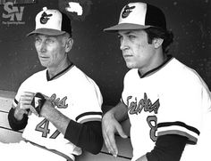 FATHER AND SON Baltimore Orioles coach Cal Ripken Sr. and son, rookie Cal Ripken Jr., on Oct. 4, 1981. (Sporting News Archives)