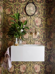 Powder room: Wow factor is added to the basement's powder room with ornate William Morris wallpaper. wallpaper An Brooklyn row house received a modern renovation William Morris Wallpaper, Morris Wallpapers, Bold Wallpaper, Bathroom Wallpaper, Powder Room Wallpaper, Wallpaper Wallpapers, Foyer Wallpaper, Bathroom Niche, Painted Wallpaper