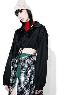 Storm Warning Cropped Jacket cuz yer heart is raging 'N whippin' up sum major waves… This sikk cropped windbreaker features a sleek black nylon construction, micro hemline with drawstrings, cinched cuffs, and snap front closure.