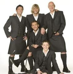 Five men dressed alike, in kilts.