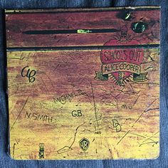 "Alice Cooper ""School's Out"" vinyl record LP (1972). Original album cover had the sleeve opening in the manner of an old wooden desk. On the other side of the cover folded out into raised legs. The record inside was draped with a pair of paper panties."