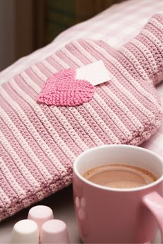 Pretty hot water bottle crochet cover with tiny heart motif
