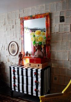 Book Page Wall, Striped Dresser, Red Mirror