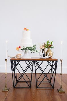 Wooden and iron modern end tables make a chic wedding cake table eat this sleek and industrial affair! Created and captured by Dear Sweetheart Events and Katie Nesbitt Photography! *Paisley & Jade vintage & Eclectic Furniture Rentals for Events, Weddings, Theatrical Productions & Photo Shoots*