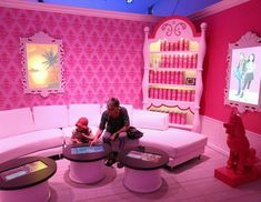 Barbie's Dream House: The Experience  A young girl and her grandmother visit the Barbie Dreamhouse Experience, May 16, 2013, in Berlin. The Barbie Dreamhouse is a life-sized house full of Barbie fashion, furniture and accessories and will be open to the public until August 25 before it moves on to other cities in Europe. (Sean Gallup/Getty Images)