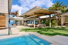 Maison tropicale moderne de Maui à Hawaii, dessinée par le cabinet d'architecte Pete Bossley Architects
