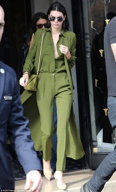 Green with envy: Kendall Jenner rose early for another day at Paris Fashion Week on Saturd...