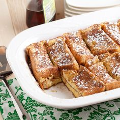 Texas French Toast Bake RECIPE (one 9×13 pan)  INGREDIENTS  1/2 cup melted butter (1 stick) 1 cup packed light brown sugar 1 loaf Texas Toast 4 large eggs 1 1/2 cup whole milk 1 TB vanilla extract 2 TB light brown sugar, mixed with 2 tsp cinnamon Powdered sugar for sprinkling Real maple syrup for serving, if desired