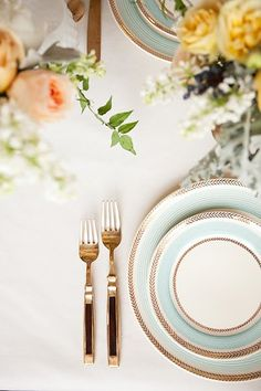 French blue and gold- and beautiful flowers... perfect table setting.