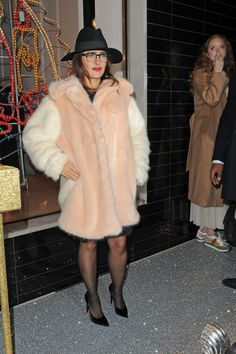 Salma Hayek and model Lily Cole attend Stella McCartney's annual Christmas Lights party at her store.