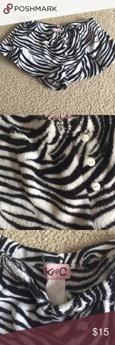 Zebra print fuzzy pajama shorts Zebra print black and white fuzzy pajama shorts. In perfect condition and only worn a couple of times at most. Has 3 white buttons along the front center. No designs. Women's size Small. Super comfortable!!! Intimates & Sleepwear Pajamas