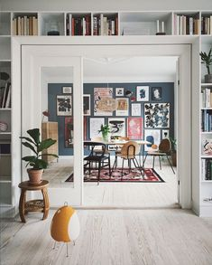 Double doors, book shelves an gallery wall in An Artful And Relaxed Apartment In. Double doors, book shelves an gallery wall in An Artful And Relaxed Apartment In Aarhus, Denmark (+ Get The Look) Dark Blue Walls, Decoration Bedroom, Wall Decor, Home Decoration, Decorations, Scandinavian Home, Interiores Design, Home Design, Danish Interior Design