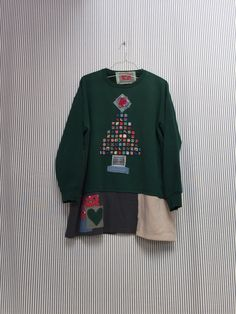 A personal favorite from my Etsy shop https://www.etsy.com/listing/499905799/upcycled-plus-size-christmas-sweatshirt