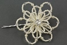 Felice+Pearl+Floral+Wedding+Hair+Grip.+The+Felice+hair+grip+is+a+stunning+hair+accessory+design,+it+features+a+gorgeous+beaded+flower.+The+bloom+comprises+of+three+rows+of+beaded+and+shaped+petals+with+a+sparkly+diamante+centre.+Each+petal+is+made+with+tiny+seed+beads,+pearls+and+crystals.+Available+as+a+hair+grip+or+hair+pin.+Available+in+a+fabulous+range+of+seed+bead,+pearl+and+crystal+colours