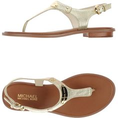 Michael Michael Kors Thong Sandal ($102) ❤ liked on Polyvore featuring shoes, sandals, gold, rubber sole shoes, leather flat shoes, toe post sandals, toe thong sandals and flat sandals