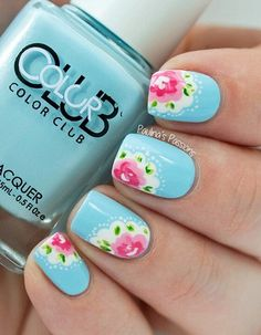 Check out this adorable blue floral nail art design. The nails are painted in baby blue polish topped with carnation pink roses, on white lace silhouettes and green leaves.