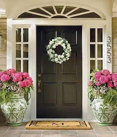 Something very simple and also very beautiful you can do for your front door entrance is to have flower pots. Display them on either side of the door or in its vicinity. If you have a covered porch then it's… Continue Reading → Front Door Planters, Front Door Porch, Front Door Entrance, Front Door Colors, Front Door Decor, Front Doors, Small Entrance, Grand Entrance, Tall Planters
