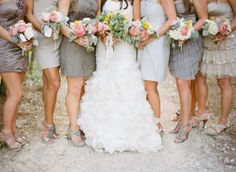 All the dresses are different - but in the same HUE...Love gray for bridesmaids dresses!