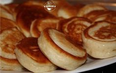 Fluffy pancakes on boiled yogurt - the most delicious and lush . Pancakes recipe for my mom! It turns out very fluffy, soft and sweet. Kefir Recipes, Cooking Recipes, Light Snacks, Russian Recipes, Fritters, Food Photo, Breakfast Recipes, Food And Drink, Yummy Food