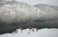 Divnogorsk, Siberia: members of a local winter swimming club warm up on a bank of the Yenisei river at -17C    Photograph: Ilya Naymushin/Reuters