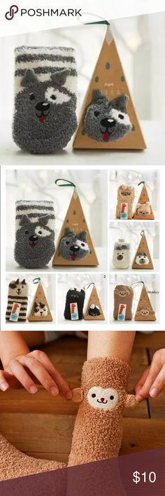 Animal Fuzzy Socks w/ Christmas Ornament Packaging NWT boutique item. These adorable fuzzy socks come in different animal styles. They also come with box packaging that resembles a Xmas ornament! Super cute stocking stuffer and gift! Animals available: Monkey, Black Cat, Lamb, Polar Bear, Gray Dog, and a brown Dog. Accessories Hosiery & Socks