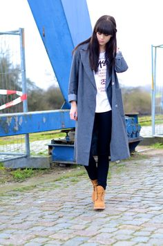 Shop this look for $147:  http://lookastic.com/women/looks/white-crew-neck-t-shirt-and-grey-overcoat-and-navy-skinny-jeans-and-tan-boots/1483  — White Print Crew-neck T-shirt  — Grey Overcoat  — Navy Skinny Jeans  — Tan Suede Boots
