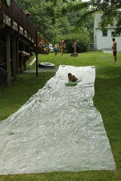 Homemade slip N slide--going to make a homemade one for our yard. Cousins welcome!reminds me of my yard & how crazy we were about our slip n slide.with cousins & all.