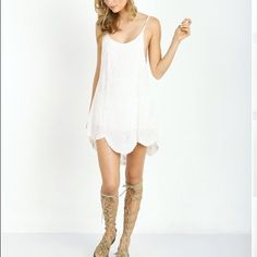 """NWT Cleobella Zia dress NWT Cleobella Zia dress •Beautiful mini dress with white base and cream embroidery details •Sustainably made with natural dyes •Size small •Adjustable straps •32.5"""" in length •NWT •$75 via PP Cleobella Dresses Mini"""