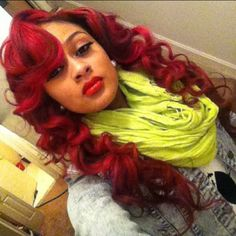 Red wand curls with swoop bang