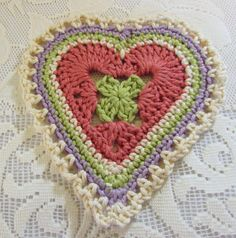 February is almost here. So I've been working on a crocheted heart that can be used for coasters or attached on a tie for cute wall buntin...