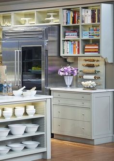 love the cube style shelves around the stove. milk glass display at end of island above fridge