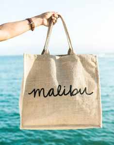 Surf's up! This reusable handmade bag is water-resistant and makes it easy to tote everything from your market finds to your beach essentials. Reusable Shopping Bags, Reusable Bags, Sisal, Shape Posters, Swimming Gear, Iron On Embroidered Patches, Beach Essentials, Jute Bags, Beach Tote Bags