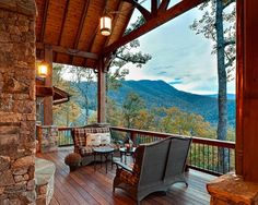 """Covered deck of my rustic """"Dream Cabin"""" overlooking a magnificent  mountain view."""
